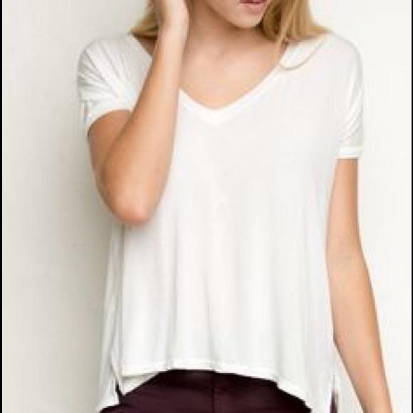 094cbbbb205f Brandy Melville Tops - Brandy Melville light blue loose v neck T-shirt